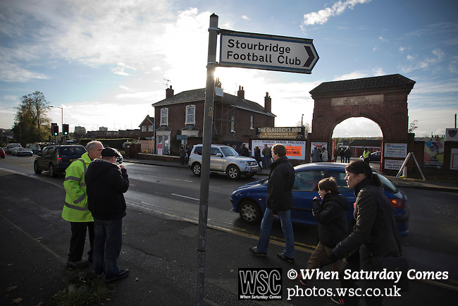 Stourbridge 4 Biggleswade Town 1, 09/11/2013. War memorial Athletic Ground, FA Cup First Round. Fans arriving outside the ground before Stourbridge FC's match against visitors Biggleswade Town FC at the War memorial Athletic Ground in the FA Cup first round, a stadium which also doubles as a cricket ground. The match was won by the home side by four goals to one, watched by a capacity crowd of 1605. It was Biggleswade's first appearance at the first round stage of the cup, winners Stourbridge went on to play Stevenage in the second round. Photo by Colin McPherson.