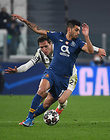 Football Soccer: UEFA Champions League -Round of 16 2nd leg Juventus vs FC Porto, Allianz Stadium. Turin, Italy, March 9, 2021.<br /> Porto's Jesus Corona (in front of) in action with Juventus' Federico Chiesa (behind) during the Uefa Champions League football soccer match between Juventus and Porto at Allianz Stadium in Turin, on March 9, 2021.<br /> UPDATE IMAGES PRESS/Isabella Bonotto