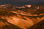 """Iceland's """"Painted Hills"""" glow during a brief break in the cloud cover."""