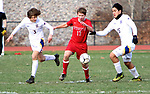 WINSTED CT. - 17 November 2020-111720SV03-#17 Josh Boucher of Northwestern tries to keep a ball from #3 Liam Money and #13 Micah Matsudaira of Housatonic during Berkshire League boy's soccer tournament action in Winsted Tuesday.<br /> Steven Valenti Republican-American