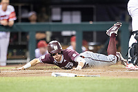 Mississippi State Bulldogs outfielder Jake Mangum (15) slides head first into home during Game 10 of the NCAA College World Series against the Louisville Cardinals on June 20, 2019 at TD Ameritrade Park in Omaha, Nebraska. Louisville defeated Mississippi State 4-3. (Andrew Woolley/Four Seam Images)