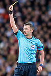 Referee Michael Oliver issues yellow card during the UEFA Champions League 2017-18 quarter-finals (2nd leg) match between Real Madrid and Juventus at Estadio Santiago Bernabeu on 11 April 2018 in Madrid, Spain. Photo by Diego Souto / Power Sport Images