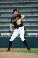 Mitch Hart #14 of the Southern California Trojans pitches against the Coppin State Eagles at Dedeaux Field on February 18, 2017 in Los Angeles, California. Southern California defeated Coppin State, 22-2. (Larry Goren/Four Seam Images)