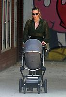 JUN 10 Karlie Kloss pushing a pram while holding mobile phone