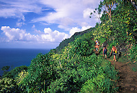 Hikers returning from Hanakapiai Beach trek along the Kalalau Trail, Na Pali Coast, Kauai