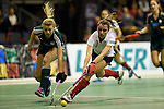 Berlin, Germany, February 01: Antonia Zengerle #23 of HTC Uhlenhorst Muehlheim and Elisa Graeve #26 of Duesseldorfer HC battle for the ball during the 1. Bundesliga Damen Hallensaison 2014/15 final hockey match between Duesseldorfer HC (white) and HTC Uhlenhorst Muehlheim (green) on February 1, 2015 at the Final Four tournament at Max-Schmeling-Halle in Berlin, Germany. Final score 4-1 (1-0). (Photo by Dirk Markgraf / www.265-images.com) *** Local caption ***