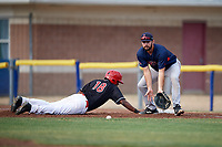 Lowell Spinners first baseman Devlin Granberg (35) fields a pickoff attempt throw as Brayan Hernandez (18) dives back into the bag during a game against the Batavia Muckdogs on July 16, 2018 at Dwyer Stadium in Batavia, New York.  Lowell defeated Batavia 4-3.  (Mike Janes/Four Seam Images)
