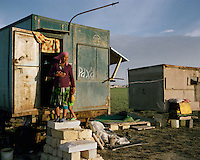Oltinoy is married to one of the Koshkar-Ata cemetery labourers and has been brought along to take care of the group. She spends her days inside their trailer, preparing meals and sheltering from the sun. The rest of the workers don't see their families for months at a time.