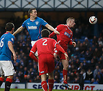 Jon Daly rises to head in the second goal for Rangers