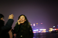 CHINA. Shanghai. A woman on the Bund. Shanghai is a sprawling metropolis or 15 million people situated in south-east China. It is regarded as the country's showcase in development and modernity in modern China. This rapid development and modernization, never seen before on such a scale has however spawned countless environmental and social problems. 2008