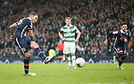 Martin Woods scores from the penalty spot for Ross County
