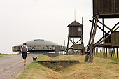 A tourist walks towards a mausoleum containing the ashes of some of those murdered at Majdanek concentration camp on the outskirts of Lublin.
