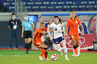 YOKOHAMA, JAPAN - JULY 30: Rose Lavelle #16 of the United States and Jackie Groenen #14 of the Netherlands battle for the ball during a game between Netherlands and USWNT at International Stadium Yokohama on July 30, 2021 in Yokohama, Japan.
