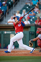 Buffalo Bisons third baseman Gio Urshela (12) hits a double during a game against the Syracuse Chiefs on July 6, 2018 at Coca-Cola Field in Buffalo, New York.  Buffalo defeated Syracuse 6-4.  (Mike Janes/Four Seam Images)