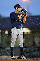 Mississippi Braves pitcher Jake Brigham (49) gets ready to deliver a pitch in the rain during a game against the Mobile BayBears on April 28, 2015 at Hank Aaron Stadium in Mobile, Alabama.  The game was suspended after the top of the second inning with Mobile leading 3-0, the BayBears went on to defeat the Braves 6-1 the following day.  (Mike Janes/Four Seam Images)