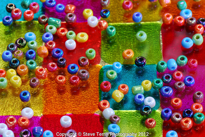 Multi colored beads on glass
