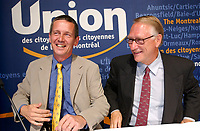 Undated  2001, Montreal, Quebec, Canada; <br /> Loyola candidate for  (Gerald Tremblay party) Union des Citoyens ;  Jeremy Searle (L) and Mayor candidate Gerard Tremblay (R) during the Montreal municipal electoral campaign.<br /> <br /> Jeremy Searle is well known in Montreal as a staunch defender of the city's heritage. In 1984, he formed the Ŕ l'action Montréal group which successfully fought the construction of an office building that would have closed McGill College Avenue at Ste. Catherine Street. He also led a campaign to save buildings with historic and architectural value from demolition in the Crescent/De Maisonneuve/Bishop/Sherbrooke block.<br /> <br /> <br /> Tremblay defeated opponent Pierre Bourque on November 4th 2001<br /> <br /> (Mandatory Credit: Photo by Sevy - Images Distribution (©) Copyright 2001 by Sevy<br /> <br /> NOTE :  D-1 H original JPEG, saved as Adobe 198 RGB