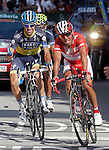 Joaquin Purito Rodriguez comes to the finish in presence of Nairo Alexander Quintana and and Jesus Hernandez (l) how celebrates the victory in the stage and the new leadership of his partner Alberto Contador during the stage of La Vuelta 2012 beetwen Santander-Fuente De.September 5,2012. (ALTERPHOTOS/Acero)