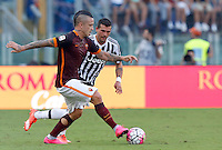 Calcio, Serie A: Roma vs Juventus. Roma, stadio Olimpico, 30 agosto 2015.<br /> Roma's Radja Nainggolan, left, is challenged by Juventus' Stefano Sturaro during the Italian Serie A football match between Roma and Juventus at Rome's Olympic stadium, 30 August 2015.<br /> UPDATE IMAGES PRESS/Riccardo De Luca