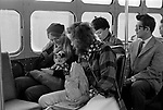 Hippie American couple with pet puppy dog riding a bus in Haight-Ashbury San Francisco. 1969 USA 60s 1960s US