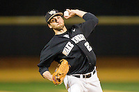 Niko Spezial (27) of the Wake Forest Demon Deacons delivers a pitch to the plate against the West Virginia Mountaineers at Wake Forest Baseball Park on February 24, 2013 in Winston-Salem, North Carolina.  The Demon Deacons defeated the Mountaineers 11-3.  (Brian Westerholt/Four Seam Images)