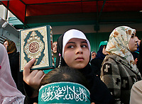 "Palestinian girl supporters of Hamas movement carry holy Quran shout anti-US President George W. Bush slogans during a protest against Bush's visit to Israel and Palestinian territories, 09 January 2008, in Gaza City. Bush landed in Israel today on the first visit of his presidency aimed at bolstering recently-revived peace talks.""photo by Fady Adwan"""