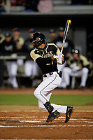 UCF Knights Gephry Pena (27) bats during a game against the Siena Saints on February 14, 2020 at John Euliano Park in Orlando, Florida.  UCF defeated Siena 2-1.  (Mike Janes/Four Seam Images)