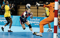 23 NOV 2011 - LONDON, GBR - Britain's Ewa Palies (#17, in blue and red) scores during the 2011 London Handball Cup match against Angola at The Handball Arena in the Olympic Park in Stratford, London (PHOTO (C) NIGEL FARROW)