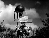 French civilians erected this silent tribute to an American soldier who has fallen in the crusade to liberate France from Nazi domination.  Carentan, France.  June 17, 1944. Himes.  (Army)<br /> NARA FILE #:  111-SC-190597<br /> WAR & CONFLICT BOOK #:  1349