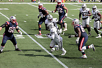 27th September 2020, Foxborough, New England, USA;  Las Vegas Raiders safety Johnathan Abram (24) carries the ball after intercepting during the game between the New England Patriots and the Las Vegas Raiders