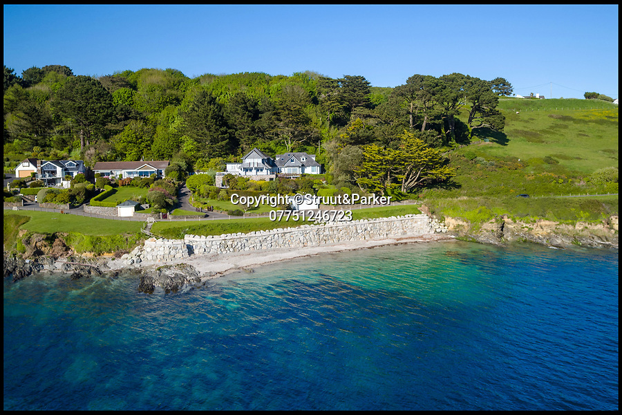 BNPS.co.uk (01202 558833)Pic: Strutt&Parker/BNPS<br /> <br /> Stunning seaside property in Cornwall - comes with its own private beach.<br /> <br /> A stunning waterfront home with its own private beach and a historic Cornish castle as a neighbour is on the market for offers over £3m.<br /> <br /> Andennis is in an exclusive coastal location next to St Mawes Castle, an artillery fort built under Henry VIII to protect against invasion from France.<br /> <br /> Estate agents Strutt & Parker, who are handling the sale, say it is one of the West Country's best waterfront properties and has magnificent panoramic views over Carrick Roads and the Fal estuary.