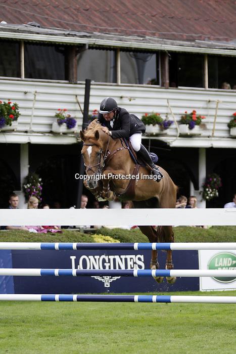 August 09, 2009: Philippe Le Jeune aboard Vigo D Arsouilles competing in the Grand Prix event. Longines International Grand Prix. Failte Ireland Horse Show. The RDS, Dublin, Ireland.
