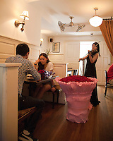 Citizen Cafe on Jianxian Road. A young couple have a romantic lunch on the second floor of Citizen Cafe.  Series of images looking at 'Trendy Shanghai' By Jonathan Browning.
