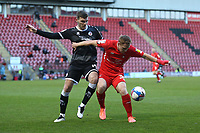 Danny Johnson of Leyton Orient and Jordan Tunnicliffe of Crawley Town during Leyton Orient vs Crawley Town, Sky Bet EFL League 2 Football at The Breyer Group Stadium on 19th December 2020