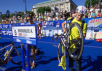 20 JUL 2013 - HAMBURG, GER - Alistair Brownlee (GBR) (right in yellow and black) of Great Britain prepares in transition before the start of the elite men's ITU 2013 World Triathlon Series round  in the Altstadt Quarter, Hamburg, Germany (PHOTO COPYRIGHT © 2013 NIGEL FARROW, ALL RIGHTS RESERVED)