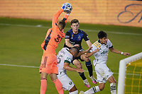 SAN JOSE, CA - SEPTEMBER 19: Aljaz Ivacic #31 of the Portland Timbers grabs a ball as Tanner Beason #15 of the San Jose Earthquakes goes up for the header during a game between Portland Timbers and San Jose Earthquakes at Earthquakes Stadium on September 19, 2020 in San Jose, California.