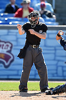 Home plate umpire Drew Freed makes a call during a game between the Myrtle Beach Pelicans and Wilmington Blue Rocks  on April 27, 2014 at Frawley Stadium in Wilmington, Delaware.  Myrtle Beach defeated Wilmington 5-2.  (Mike Janes/Four Seam Images)