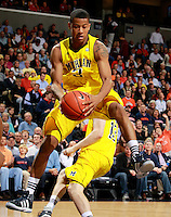 CHARLOTTESVILLE, VA- NOVEMBER 29: Trey Burke #3 of the Michigan Wolverines grabs a rebound during the game on November 29, 2011 at the John Paul Jones Arena in Charlottesville, Virginia. Virginia defeated Michigan 70-58. (Photo by Andrew Shurtleff/Getty Images) *** Local Caption *** Trey Burke