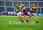 Kerry's Louise Ní Mhuircheartaigh still holds possession as Wexfords Sarah Harding Kenny puts in a challenge in the Lidl LGFA National football league game in Fitzgerald Stadium Killarney on Sunday.