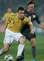Jack McInerney (9) battles against Jon Aurtenetxe (3). Spain defeated the U.S. Under-17 Men National Team  2-1 at Sani Abacha Stadium in Kano, Nigeria on October 26, 2009.
