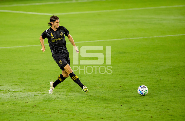 LOS ANGELES, CA - SEPTEMBER 23: Dejan Jakovic #5 of LAFC passes off the ball during a game between Vancouver Whitecaps and Los Angeles FC at Banc of California Stadium on September 23, 2020 in Los Angeles, California.