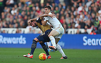 Federico Fernandez of Swansea City grapples with Olivier Giroud of Arsenal during the Barclays Premier League match between Swansea City and Arsenal played at The Liberty Stadium, Swansea on October 31st 2015