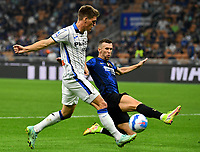 Calcio, Serie A: Internazionele Milano vds Atalanta Bergamasca Calcio Giuseppe Meazza stadium, Milan, September 25, 2021.<br /> Atalanta's Joakim Maehle (L) in action with  Inter's Ivan Perisic (R) during the Italian Serie A football match between Inter and Atalanta at Giuseppe Meazza stadium, on September 25, 2021.<br /> UPDATE IMAGES PRESS/Isabella  Bonotto