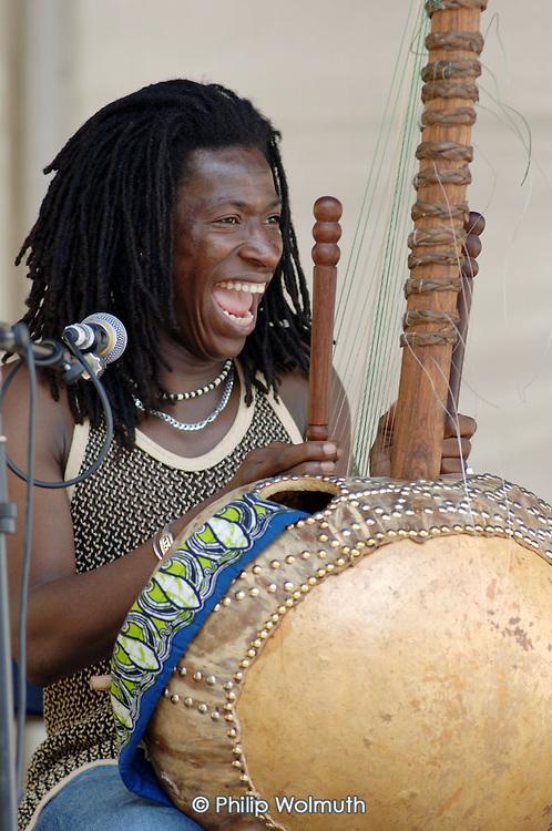 West African cora player performs at Church Street Summer Festival 2005, Paddington, London.