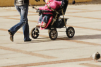 Poland, Tarnow, Woman with baby carriage