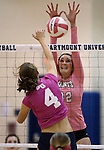 Marymount's Emily Shultis gets a block during a college volleyball match against Shenandoah at Marymount University in Arlington, Vir., on Tuesday, Oct. 8, 2013.<br /> Photo by Cathleen Allison