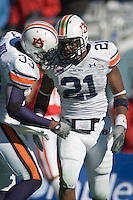 01 January 2007: Auburn defender Karibi Dede (#21) is mobbed by teammates after catching an interception during the 2007 AT&T Cotton Bowl Classic between The University of Auburn and The University of Nebraska at The Cotton Bowl in Dallas, TX.