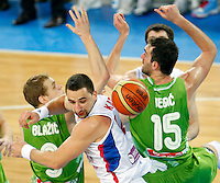 """Serbia`s Rasko Katic (L) in action during European basketball championship """"Eurobasket 2013"""" classification basketball game from 5th to 8th place between Serbia and Slovenia in Stozice Arena in Ljubljana, Slovenia, on September 19. 2013. (credit: Pedja Milosavljevic  / thepedja@gmail.com / +381641260959)"""