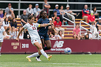 NEWTON, MA - AUGUST 29: Michela Agresti #23 of Boston College passes the ball as Jada Konte #7 of University of Connecticut pressures during a game between University of Connecticut and Boston College at Newton Campus Soccer Field on August 29, 2021 in Newton, Massachusetts.