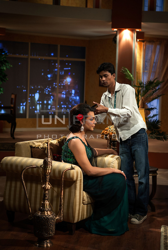 Last touches to Begum's hairstyle before the show starts.